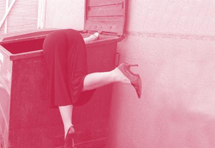 Lady looking in refuse bin